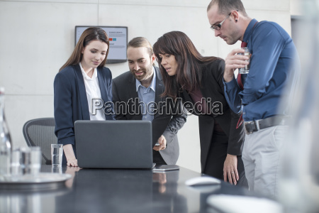 colleagues having a meeting with laptop