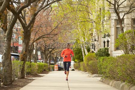 woman running in boston massachusetts usa