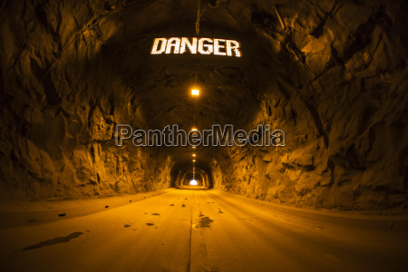 tunnel in cave with danger sign