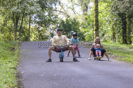 family playing in park bedugul bali
