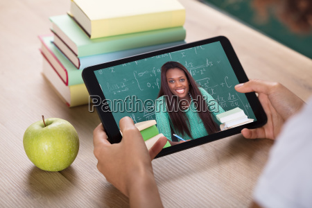 video conferencing with female teacher on