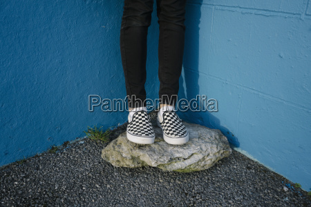teenage girl wearing black trousers and