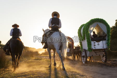 group of people in horse drawn