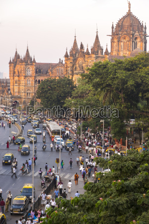 street busy with car and pedestrian