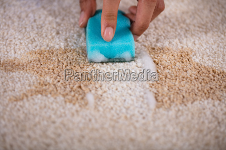 janitor cleaning stain on carpet