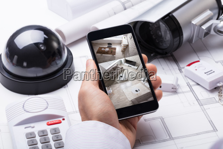person hand using home security system