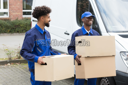 two men holding the cardboard boxes