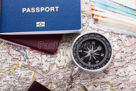passport and compass on map