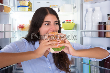 happy woman eating burger