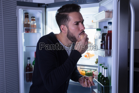 close up of a man eating