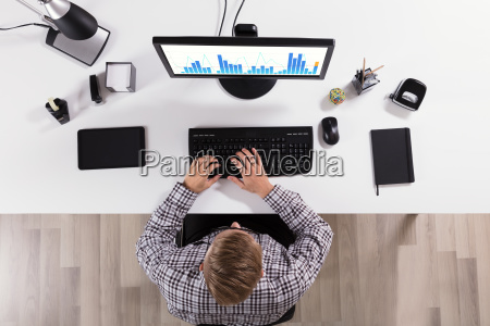 businessman working on business graph