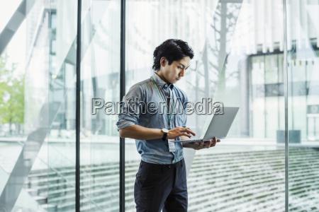 businessman wearing blue shirt standing indoors
