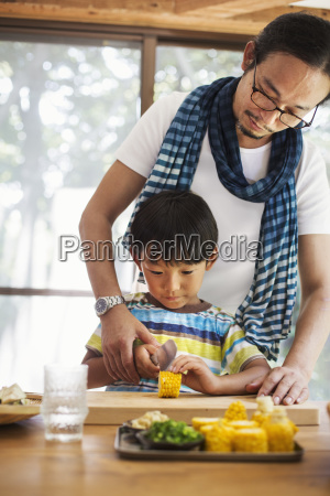 man and boy standing at a
