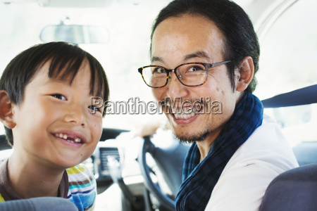 man wearing glasses and boy sitting