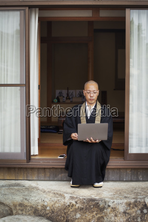 buddhist monk with shaved head wearing