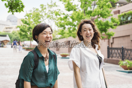 two women with black hair wearing