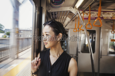 a woman on a moving train