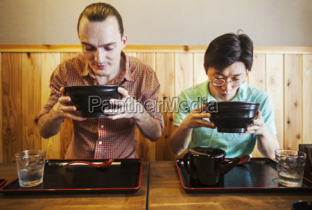 two people in a noodle cafe