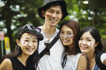 smiling man and three young women