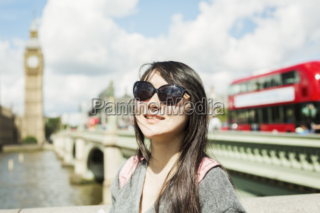 smiling woman with black hair wearing