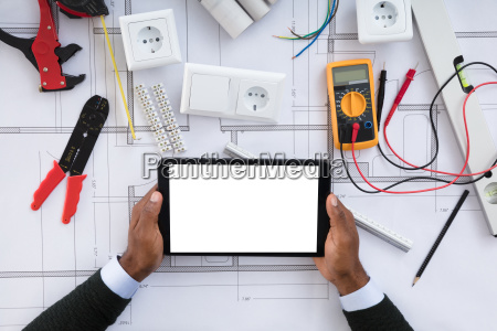 person holding blank screen digital tablet