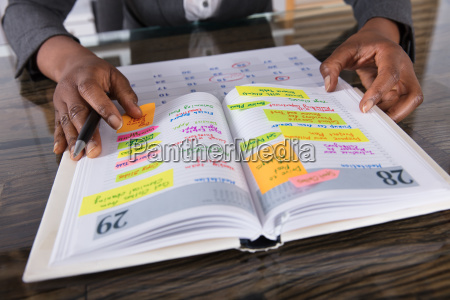 businesswoman looking at list of business