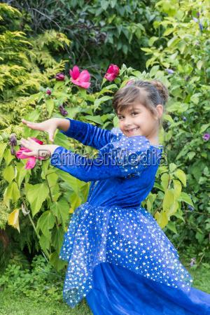 portrait of little girl in blue
