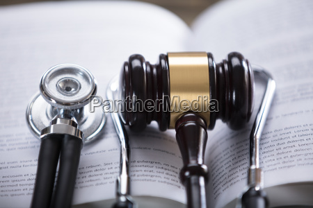 close up of stethoscope and gavel