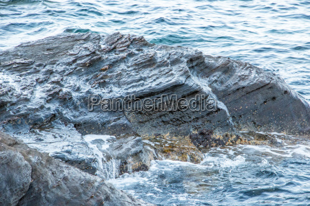 huge rocks and waves of the