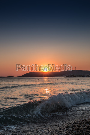 sunset and waves at the beach