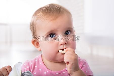 cute baby girl eating food