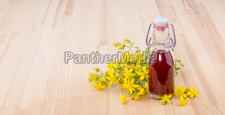 herbal oil with fresh flowering st