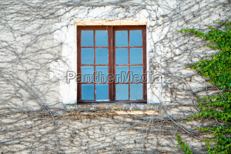 window in outdoor wall of house