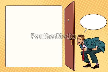 man peeping in the keyhole