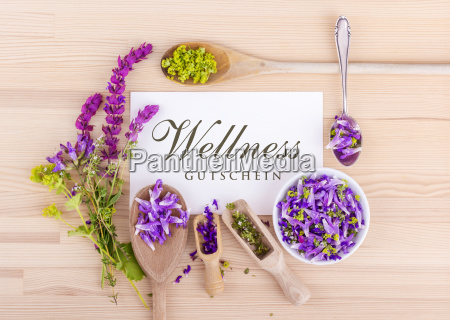 wellness coupon with flowers of sage