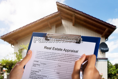 person filling real estate appraisal form