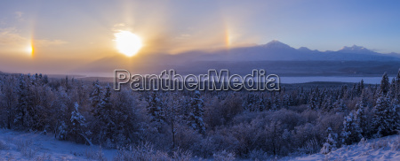 parhelia sundogs surround the sun on