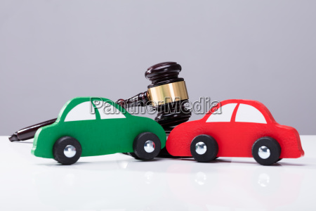 green and red car in front