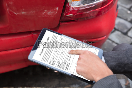 insurance agent filling insurance claim form