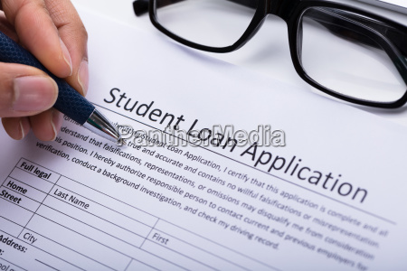 person filling student loan application form