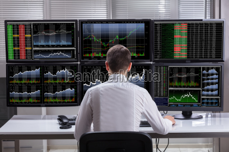 stock market broker analyzing graphs on