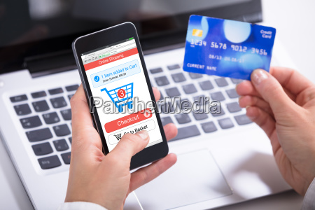 woman holding credit card in hand