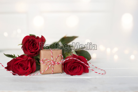 romantic red roses with a gift