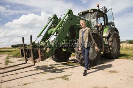 smiling mature woman walking by agricultural