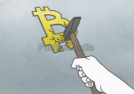 cropped hand breaking bitcoin symbol with