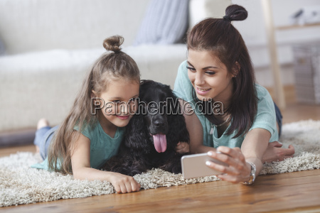 young woman with daughter and dog