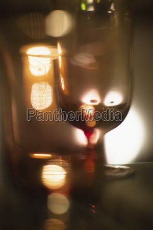 abstract image of wineglass against illuminated
