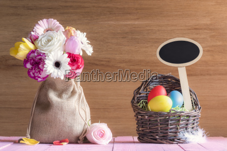flowers and easter basket with a