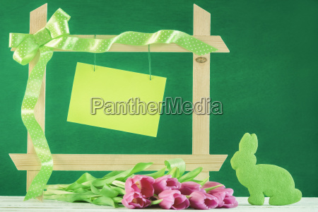 frame with paper note and tulips