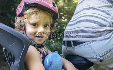 portrait of little girl with helmet